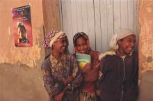 A group of girls laughing in a doorway